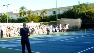 Kim Clijsters tries to return Andy Roddick's serve in Miami