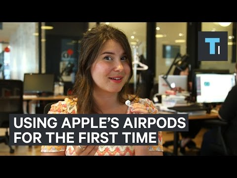 People try Apple's wireless AirPods for the first time
