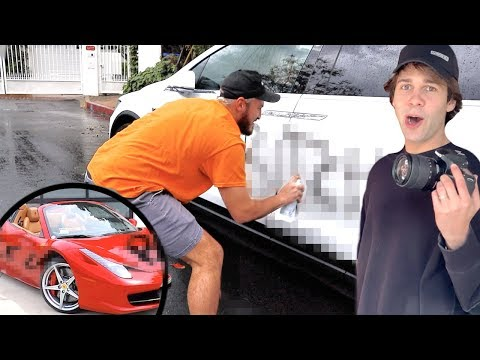 SPRAY PAINTING HIS FERRARI AND TESLA!!