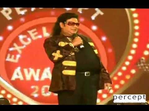 Suresh Menon does the Bappi Da act at Percept Awards