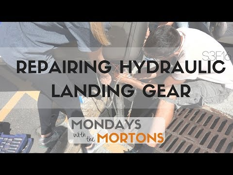 Fixing our Leaking Sinking Hydraulic Landing Gear on our Fifthwheel in a Walmart parking lot!