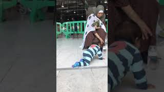 Omar playing inside the Haram Sharif
