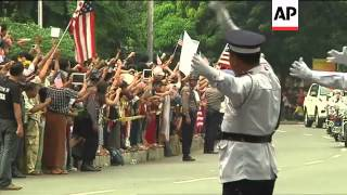 Crowd lines up outside Suu Kyi home to welcome US president