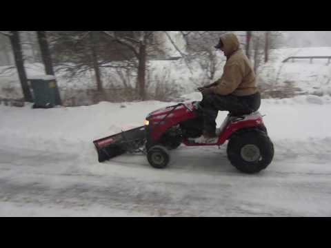 Plowing snow with lawn tractor without tire chains using 22in. atv tires.