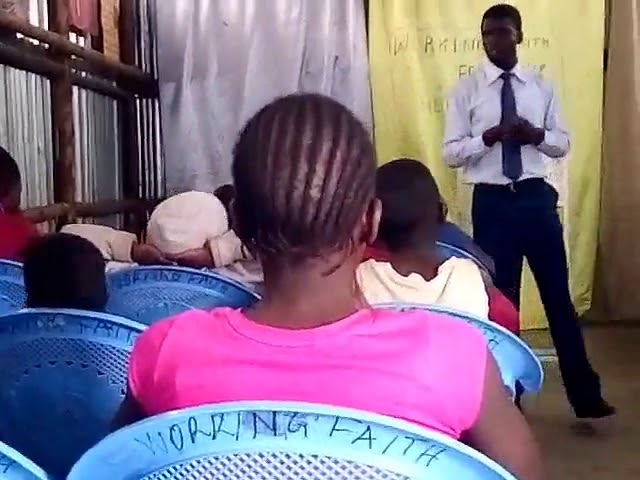 Brother Peter Teaching Children Kibera Slum Kenya