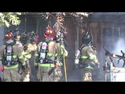 Firefighters Battle A House Fire - Firefighting Footage For TV Use