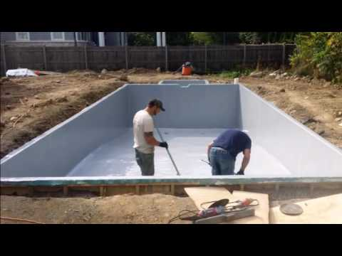 Affordable Pools Inc Custom built fiberglass pool with spa spill over