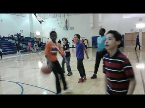 Jason playing basket ball in Francis Scott Key middle school