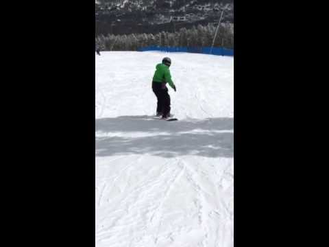 Walker learning to snowboard