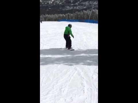 Walker learning to snowboard