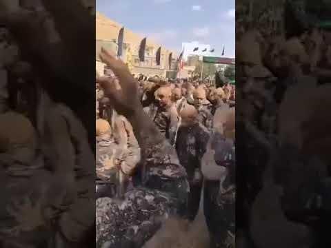 ميليشيات إيرانية يتبركون بوحل مصطنع من (عين علي) في منطقة الميادين شرق سورية