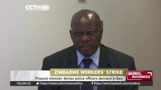 Zimbabwe's finance minister denies police officers demand bribes