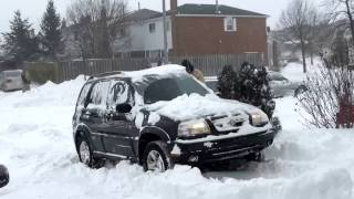 Suzuki Grand Vitara  vs. Toyota Yaris in Snow(The Yaris is moving around almost cleared surface, Where as the Grand Vitara is rolling over the snow mountain.., 2013-02-09T03:48:28.000Z)