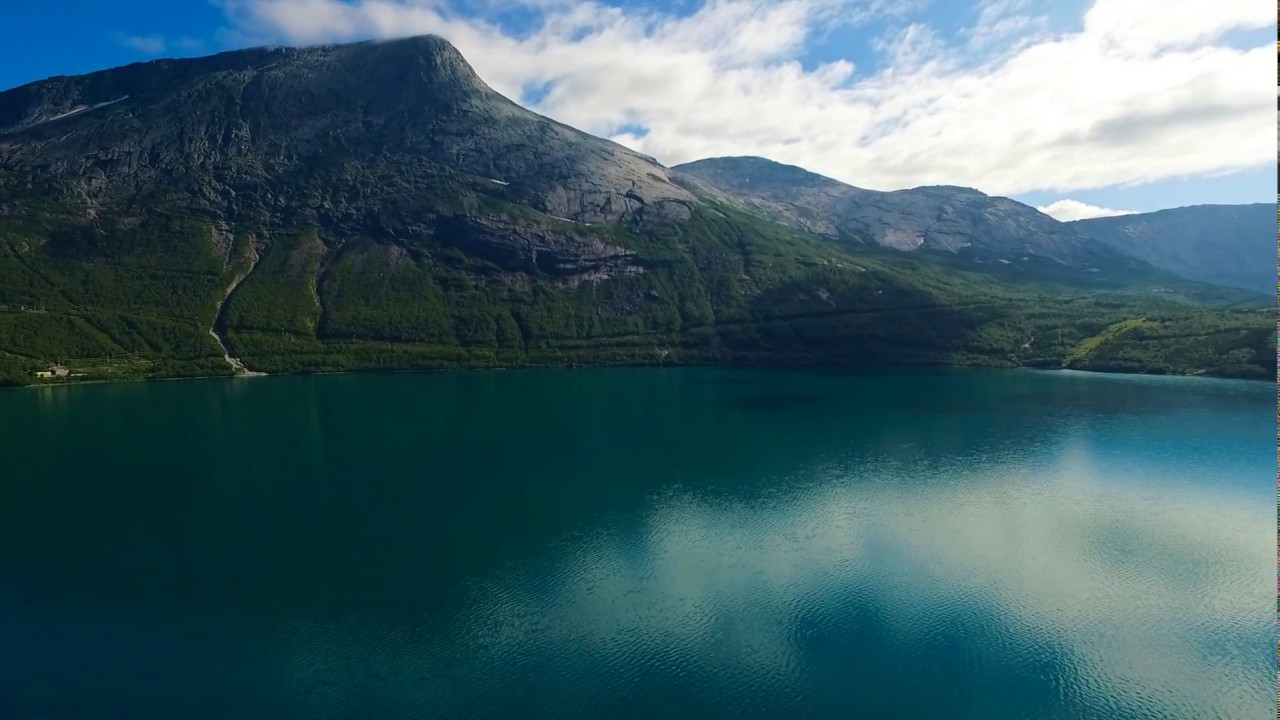 Biking along Straumvatnet in Sørfold
