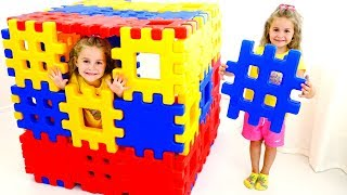 Nadia and Mom build a magic cube from Toy Lego puzzles Blocks