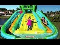 Diana and Roma play with Inflatable water slide