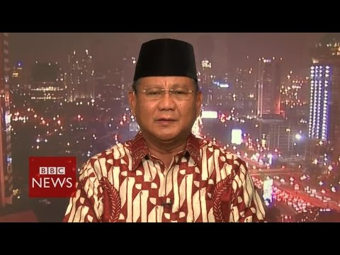 'Man of the people is an act' says Subianto about Widodo - Indonesia elections - BBC News
