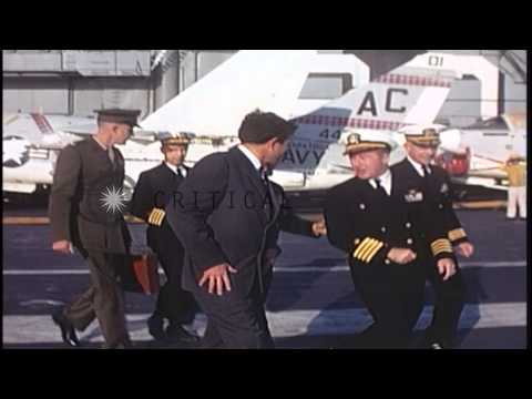 US Secretary of Navy Chafee and Vice Admiral Richardson don Mae West on USS Sarat...HD Stock Footage