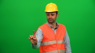 Engineer Man Touching Screen on Green Background | Stock Footage - Videohive