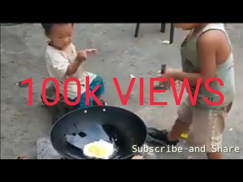 Four Year Kid Making Eggs Fried Rice For His Younger Brother