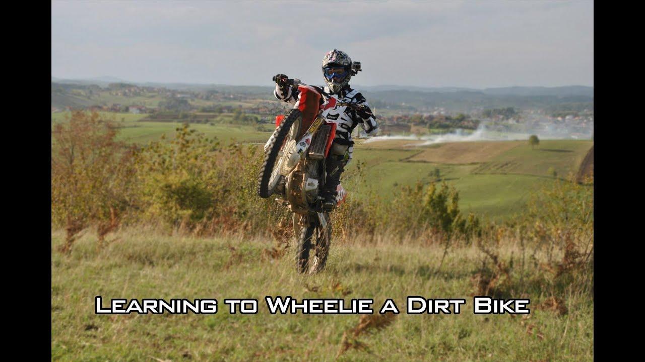 how to ride a wheelie on a dirt bike