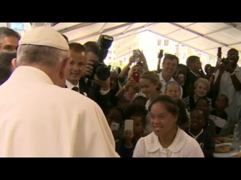 Pope Francis meets with the homeless