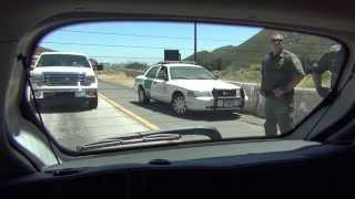 US Border Patrol Checkpoint Agents route traffic around Halted Citizen, Pine Valley, CA, 00005