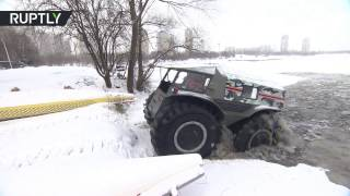 Off road monster  Russian all terrain vehicle drives across ice and into water to save lives