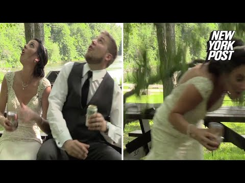 Tree branch nearly takes out bride and groom