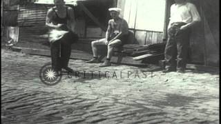 Unemployed men living in shacks as they take to their daily chores  in New York C...HD Stock Footage