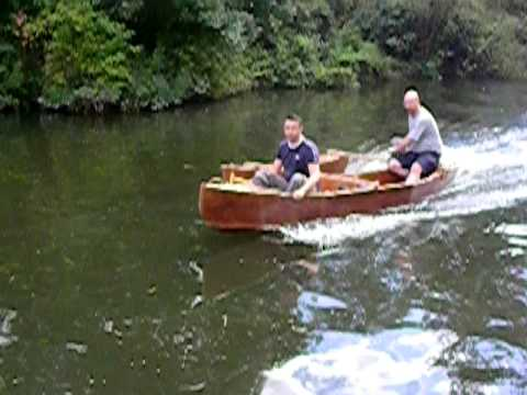 Canoe with outboard - YouTube