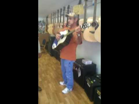 Music shop owner bustin out some tunes for us in Lebanon, VA