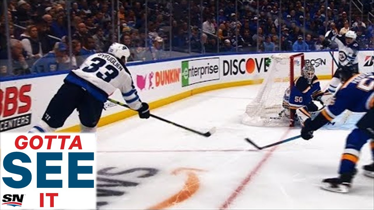 GOTTA SEE IT: Dustin Byfuglien Scores By Banking Puck Off Jordan Binnington's Head And In