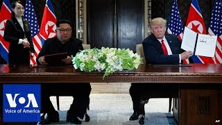 IN PHOTOS: Trump, Kim Sign Summit Agreement
