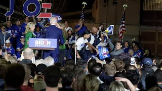 Joe Biden gets rushed on stage by anti-dairy protesters during Super Tuesday speech