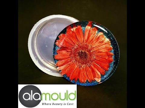 Casting Red Gerber flower into Alamould coaster mold. Alamould Ultimate Resin