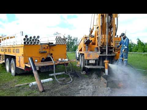 TH-60 drilling a water well