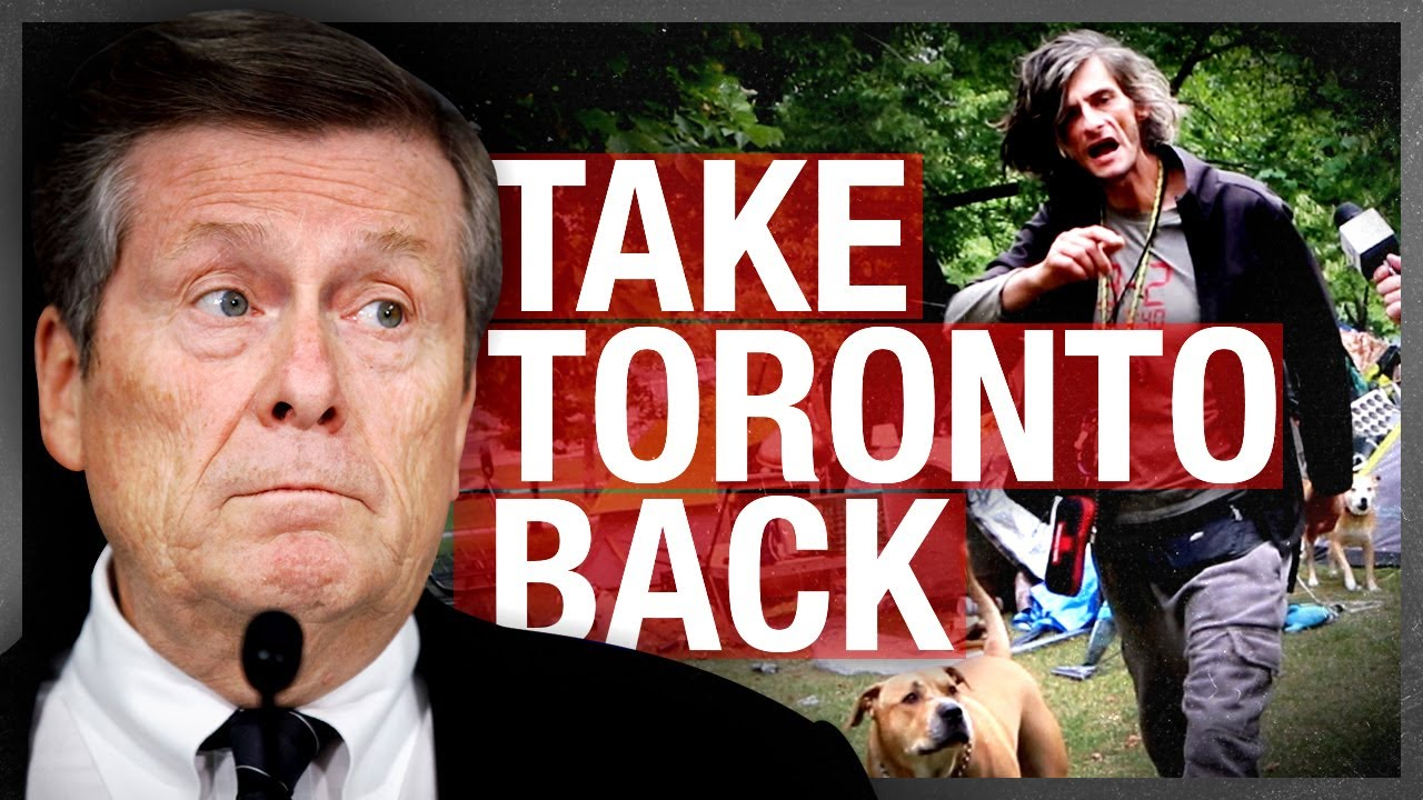 SHOCK: Hobo living illegally in a Toronto park sics vicious dogs on reporter