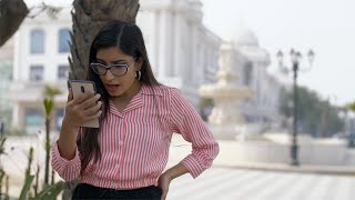 Attractive Indian girl is shocked after reading bad news online on her smartphone