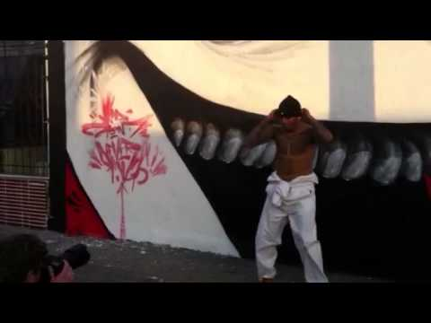 Chris brown doing karate kicks in front of kid zoom mural for Chris brown mural