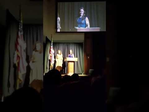 Jana Schammel accepts the Outstanding Senior Award from John Brown University