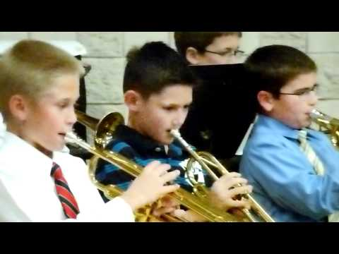 Trey playing the trumpet at TVES- Tanque Verde Elementary School
