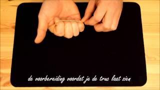 Leer goochelen truc 6: verspringende elastiek