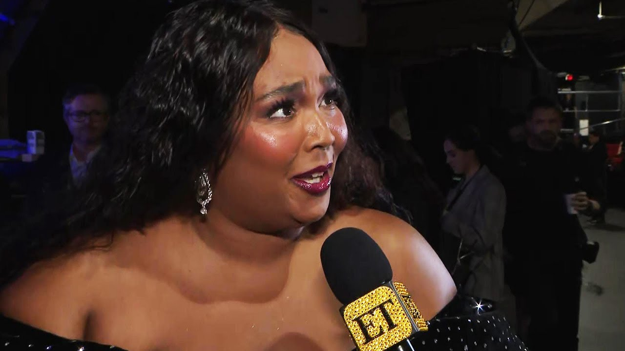 Lizzo REACTS to Her GRAMMY Win, Says She Dropped Her Grammy! (Exclusive)