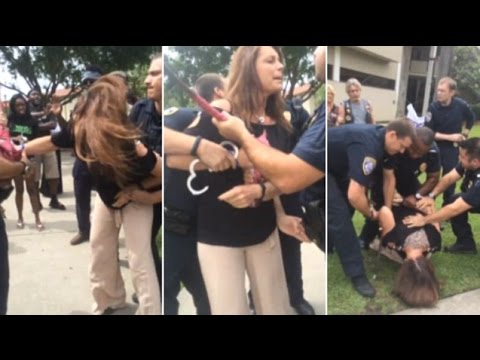 Female Air Force vet arrested trying to stop US flag protest