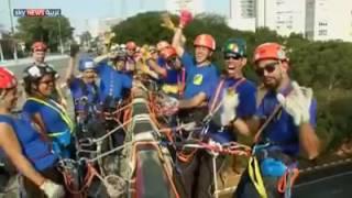 شاهد.. عشاق التسلق يشكلون العلم الأوليمبي بأجسادهم في ساو باولو