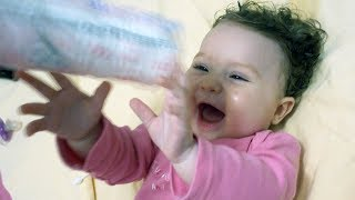 Happy Baby Laughing Hysterically at Plastic Bag