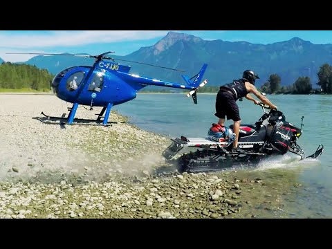 Snowmobile on water, shot from a Helicopter. Filmed in 4K!