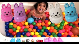 Sefu Playing with Colorful balls and open Easter Bunny Eggs Surprise toy. Children Family funny game