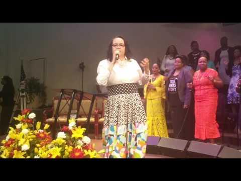 Melanie Daniels leading worship at Agape Family Worship Center